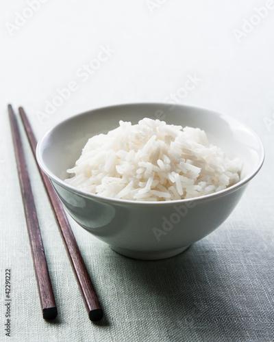 Long grain rice bowl with chopsticks