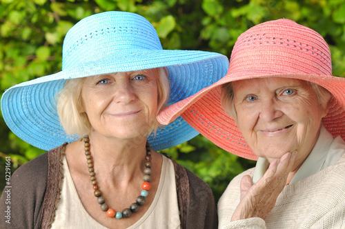 Happy women in hats.
