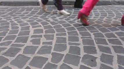 Rushing crowd with legs in different footware