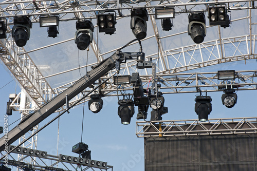 Scaffolding with lights and crane camera above the stage