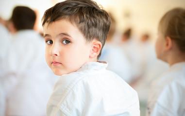 Karate children training in sport hall