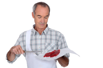 Butcher holding red meat