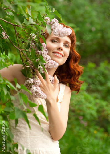 Woman in summer garden