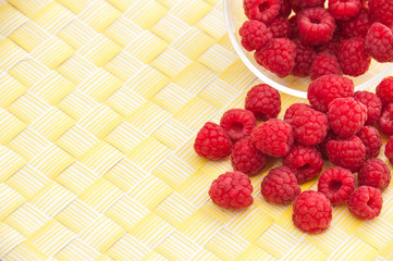 Raspberries on a yellow background