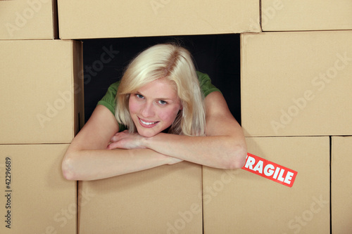 Woman stood amongst cardboard boxes