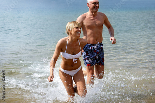 Cheerful couple bathing in the sea