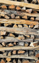neatly stacked logs of firewood