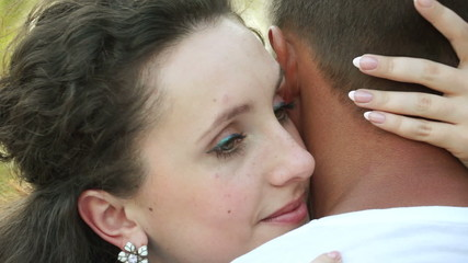 Young adult kissing her boyfriend