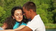 Portrait  happy couple in love in the park. Slow motion