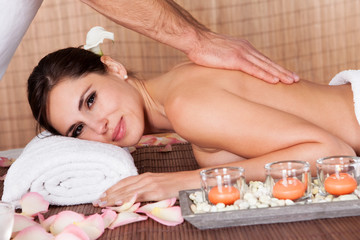 Beautiful young woman getting back massage
