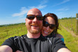 Happy couple wearing sunglasses at a winery