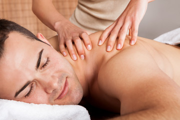 Young man getting shoulder massage