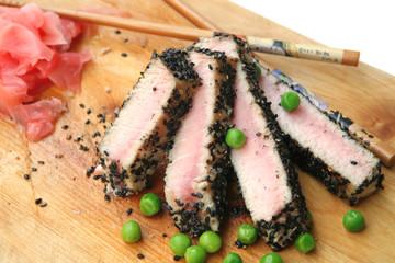roast tuna sliced on wood