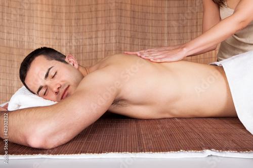 Young man getting shoulder massage