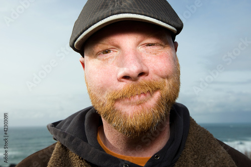 Friendly Irish Man with a red beard and a duck bill cap