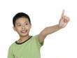 a cute little boy pointing upward