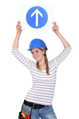 Female construction worker with an arrow pointing up