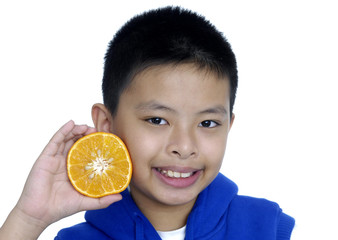 Cute kid smiling. holding fresh oranges.