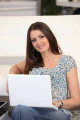 Brunette woman with laptop