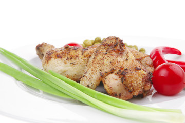 chicken legs  grilled and garnished