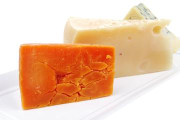 blue stilton roquefort with orange cheddar and yellow parmesan