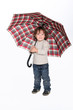 Young boy holding an umbrella