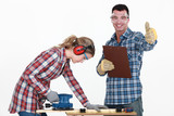 Couple working at a workbench poster