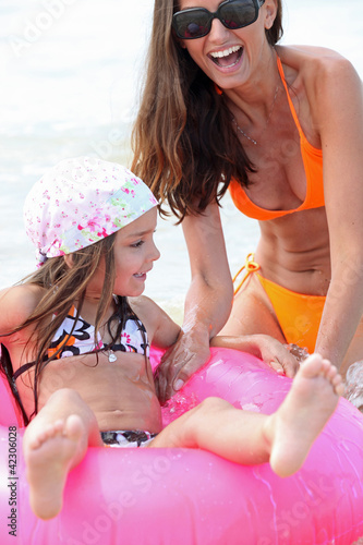 Mum and daughter messing around in the water