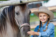 Lovely cowgirl and horse on a ranch