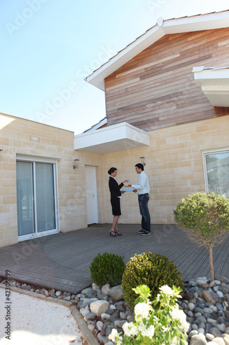 Woman handing house keys