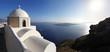 Santorini with white church against sunset, Greece