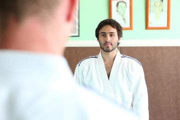 Men preparing for a b out of judo