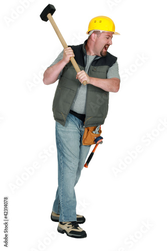 Man with hammer hitting