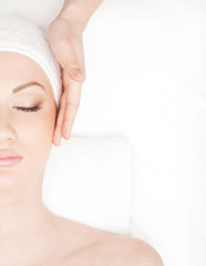 Portrait of a young woman laying on a spa procedure