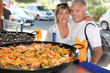 Couple in front of paella