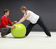Detaily fotografie Pregnant woman exercising with personal trainer