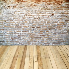 old brick wall room with wooden floor