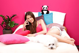 nice teenager making a phone call in her room with her little wh