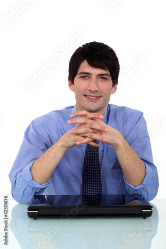 Relaxed man sitting at a desk