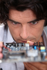 Man looking at a motherboard