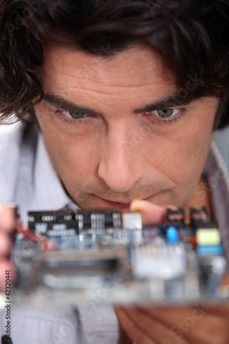 Man looking at a motherboard