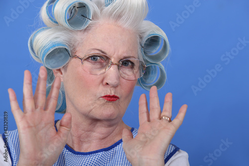 Old lady wearing hair rollers