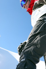 Close-up of male snowboarder