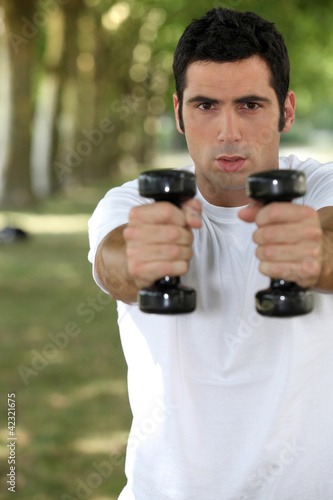 Man lifting weights in park