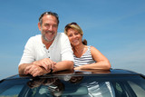 Fototapety Senior couple in convertible car enjoying day trip