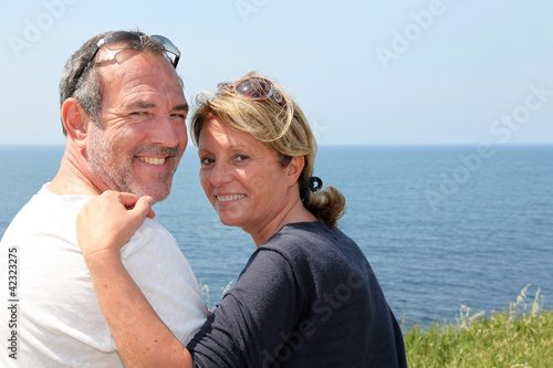 Cheerful senior couple relaxing on vacation