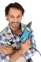Tradesman holding an electric screwdriver