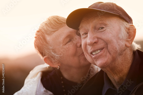 Woman Kisses Smiling Man