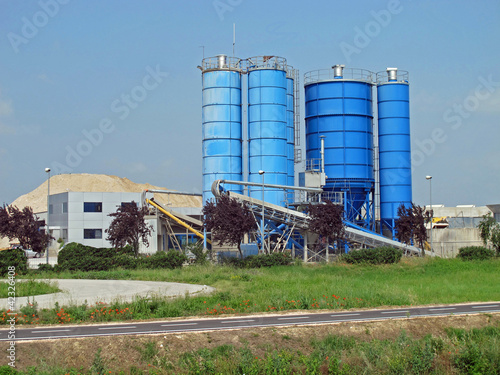 high silos to contain the cement and the sand for the building i