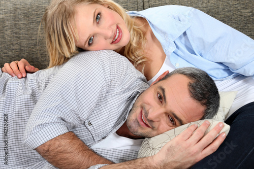 sweet couple embracing on the couch